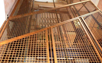 Hand made decorative mesh lift shaft guard